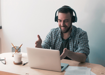 remote worker assisting on a call with headphones