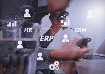 logos of HR, ERP and CRM on a photo of someone holding a headset